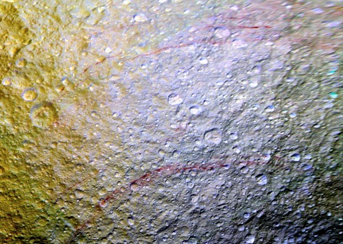It Looks Like Someone Drew On Saturn's Moon Tethys With A Red Crayon