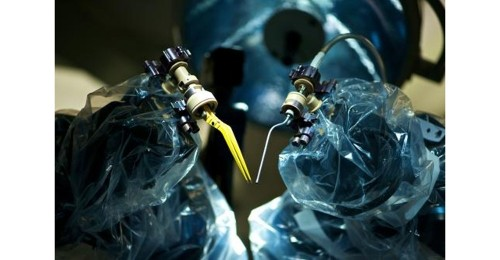 The Microscopic Future of Surgical Robotics