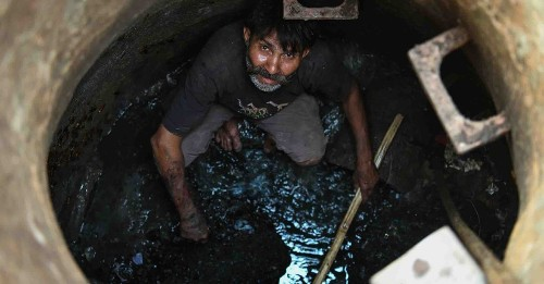 182,000 Indians clean sewers largely by hand. These robots could help.