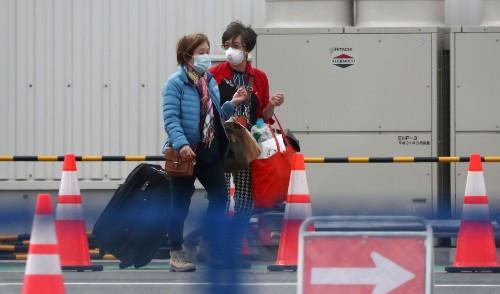 Passengers depart coronavirus cruise ship at last; Japan's effort under fire