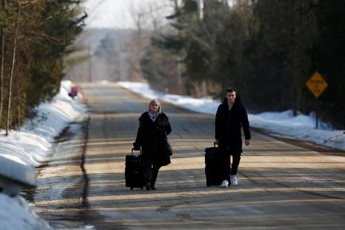 As asylum-seekers trek north, Canada examines border loophole