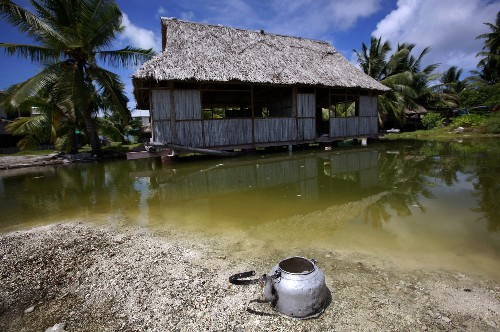An abandoned house next to a small lagoon on South Tarawa in the central Pacific island nation of Kiribati in 2013. Nations like Kiribati and the Marshall Islands may disappear due to climate change.