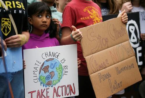 Teenage activist Greta Thunberg takes protest to climate-change denier Trump