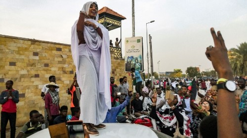 Here's the story behind the iconic image of the Sudanese woman in white