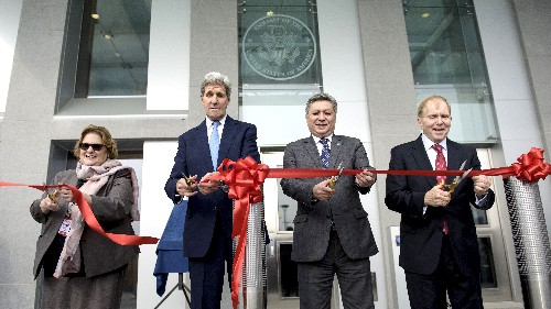 Secretary of State John Kerry takes part in a ceremony in October to open the new US embassy in Bishkek, Kyrgyzstan, together with US ambassador, Sheila Gwaltney (L). Gwaltney was confirmed by the Senate in August but dozens of her peers are still pending