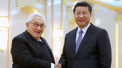 Chinese President Xi Jinping (R) shakes hands with one of American history's greatest statesman, Henry Kissinger, at the Great Hall of the People in Beijing on March 17, 2015.