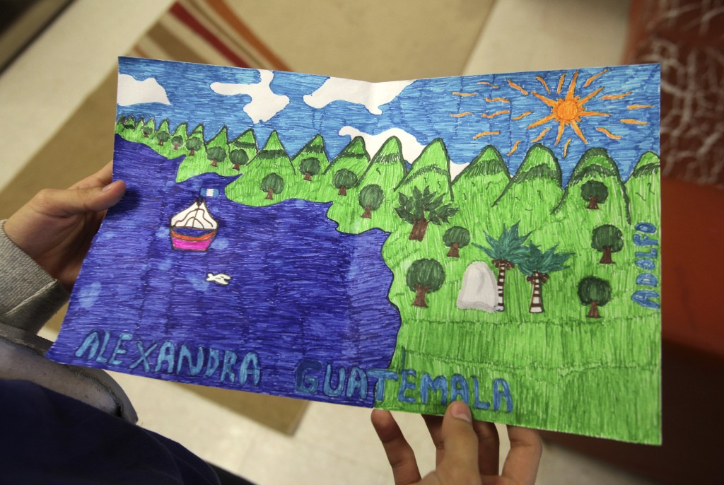 Alexandra from Guatemala shows a drawing she made at the shelter for underage immigrants and repatriated minors