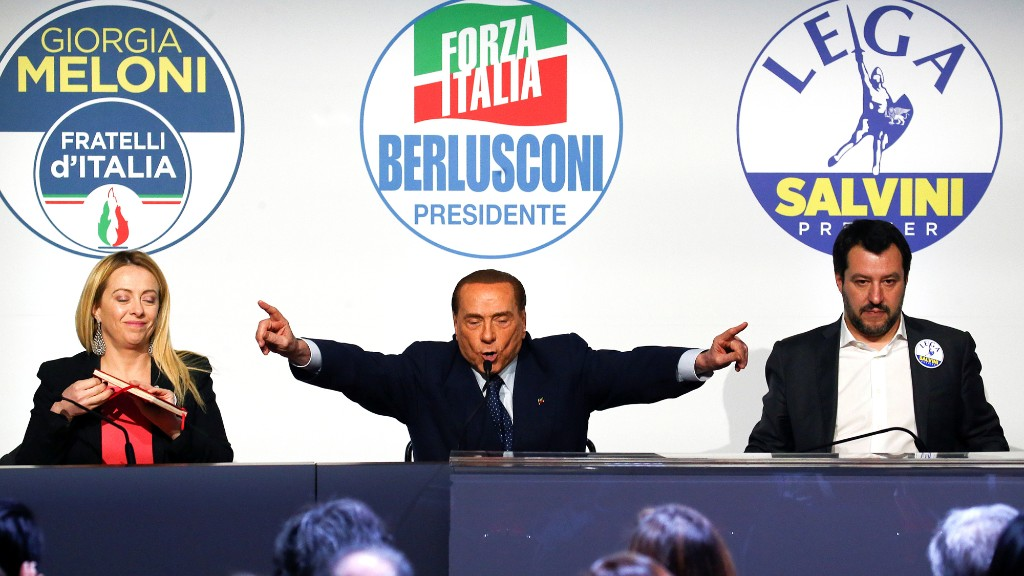 Forza Italia leader Silvio Berlusconi speaks flanked by Fratelli D'Italia party leader Giorgia Meloni and Northern League leader Matteo Salvini during a meeting in Rome.