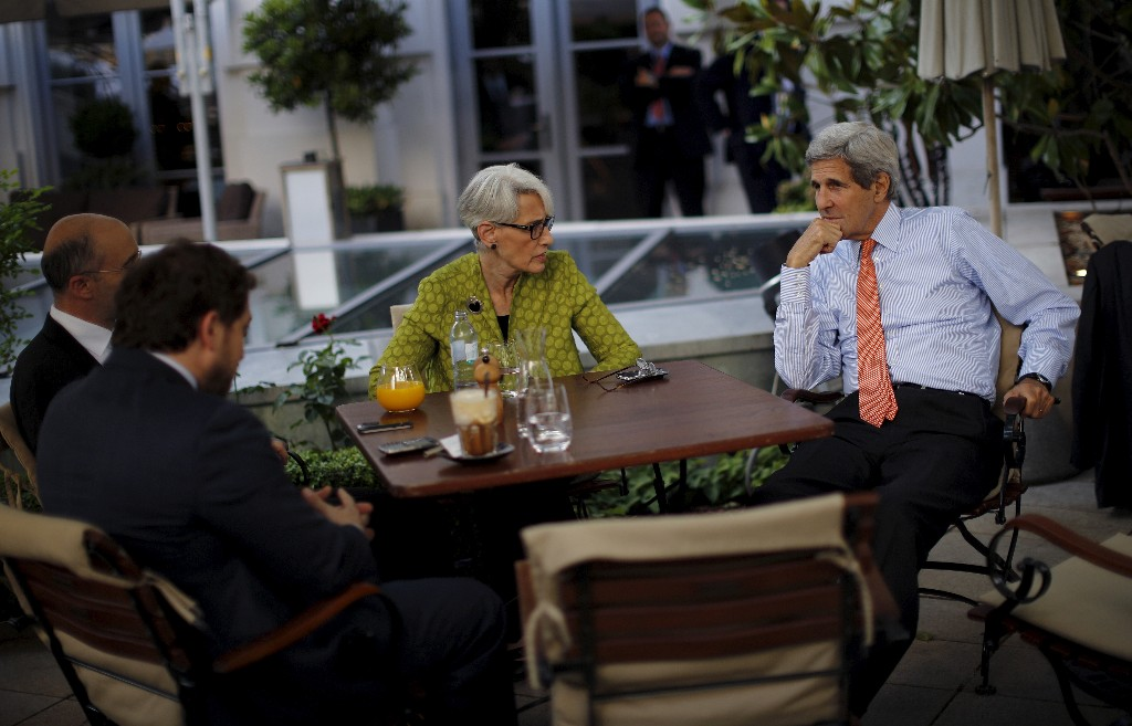 U.S. Secretary of State John Kerry (R), U.S. Under Secretary for Political Affairs Wendy Sherman (C), National Security Council point person on the Middle East Robert Malley (L) and Chief of Staff Jon Finer (2nd L) meet on the terrace of a hotel where the