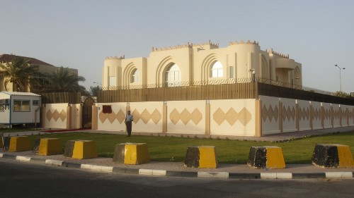 Why negotiations between the US and Taliban mostly take place in Qatar