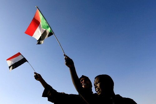 A year after revolution, Sudan celebrates but still faces squeeze of sanctions