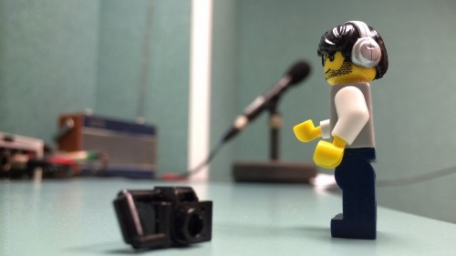 You wouldn't believe the situations a hard-working Lego photographer finds himself in