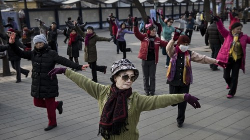 Old Chinese women can't stop won't stop dancing in the streets