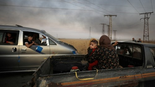 'We feel helpless,' says Kurdish woman forced to flee north Syria