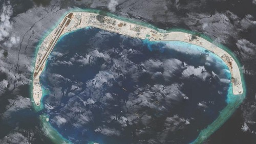 """Photos: How a """"fishermen's shelter"""" on stilts became a Chinese military base in the South China Sea"""