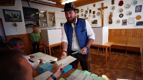 Bavarian voters punish Merkel's allies by splintering to the left and right