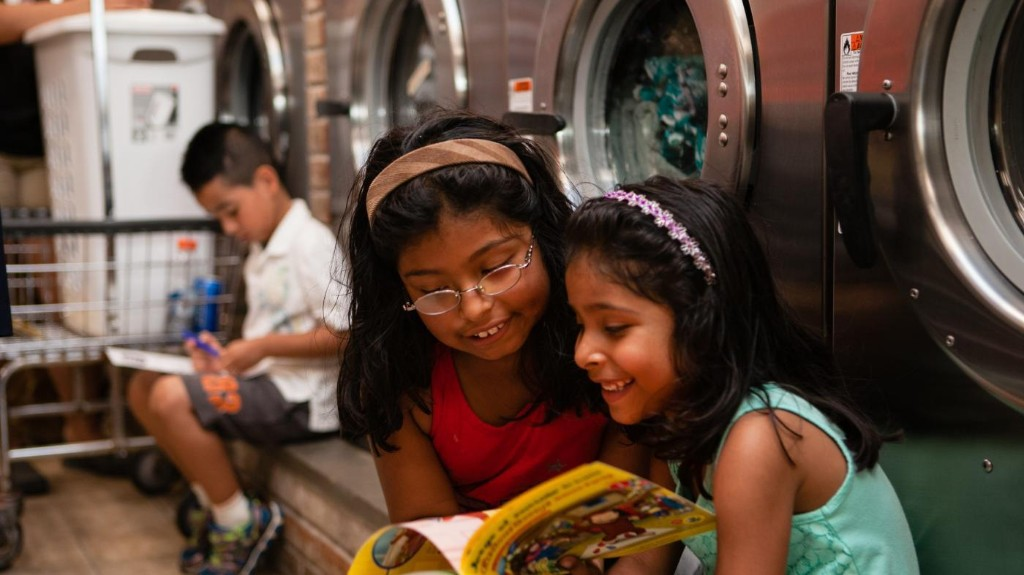 Clinton Foundation's laundromat libraries aim to boost literacy