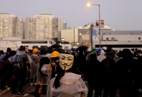 China threatens Hong Kong's judicial independence over mask ban ruling