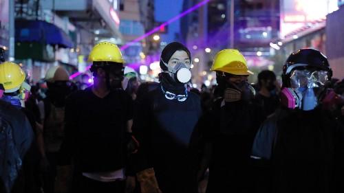 With Trump silent, Canada and EU urge de-escalation in Hong Kong