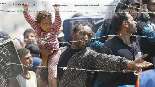 Philosophers can't agree on how much we should help refugees—or even whether we should