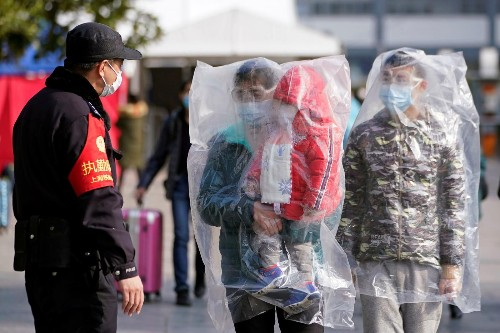 Chinese cities try to flush out coronavirus patients by stopping cough medicine sales
