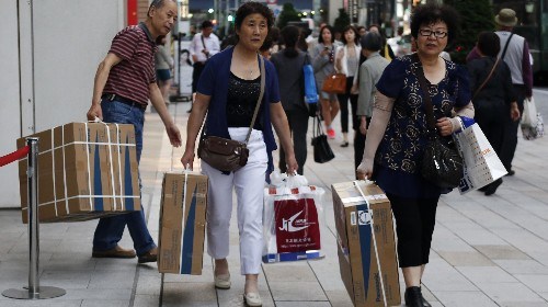 Swarms of Chinese tourists make it tough for the Japanese to vacation at home
