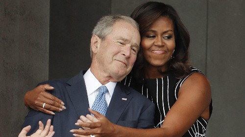 A powerful image of Michelle Obama and George W. Bush for the ages
