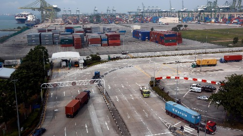 Self-driving trucks will soon haul cargo between shipping terminals in Singapore
