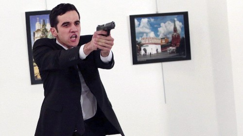 Russia's ambassador to Turkey was assassinated in public at a photo exhibit in Ankara