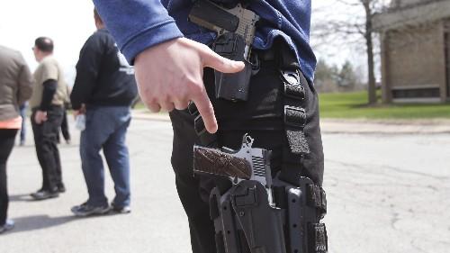 Open carry of guns in stores banned by Walgreens, Wegmans, CVS