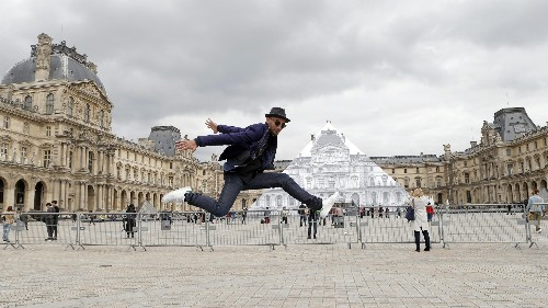 Artist JR took over the Louvre and made the pyramid disappear