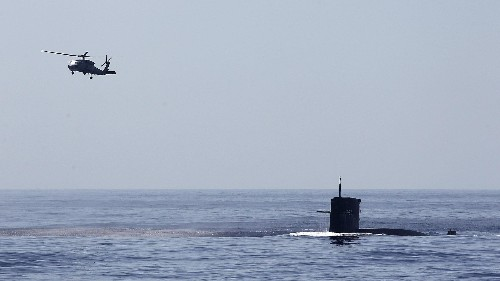 China wants foreign submarines to stop traveling below the surface in the vast waters it claims