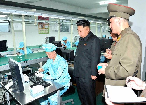"Scenes from Kim Jong-un's visit to North Korea's first ""hand-phone"" manufacturing plant"