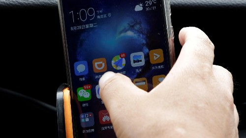 China's ride-hailing giant Didi opens app to rivals