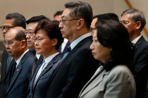 Hong Kong leader Carrie Lam faces questions over thug violence