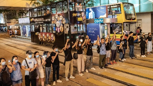 Photos: Hong Kong protesters unify in a human chain across the city
