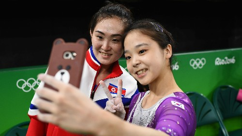 The Olympics bring North and South Korea together—at least in one iconic selfie