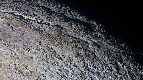 """Pluto's surface looks like """"dragon scales"""" in NASA's new high-res color photos"""