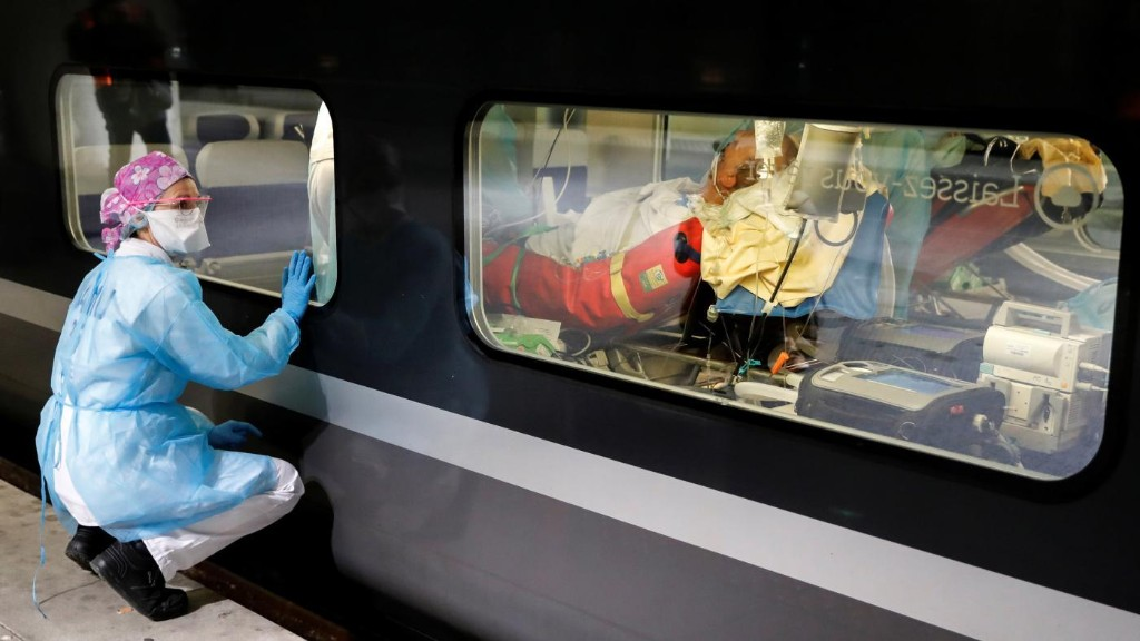 Photos: Hospitalized coronavirus patients are being moved out of Paris by train