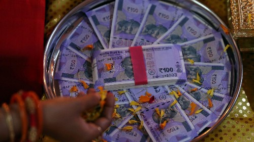 Indian rupee breached $70 as crude oil softens
