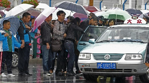 China's versions of Uber could fix city cab shortages