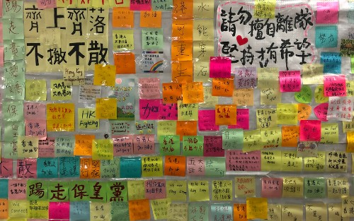 Post-it notes spread protest message on Hong Kong's Lennon Walls