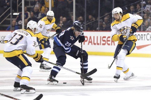 Jets blank Preds, clinch playoffs on Connor's hat trick