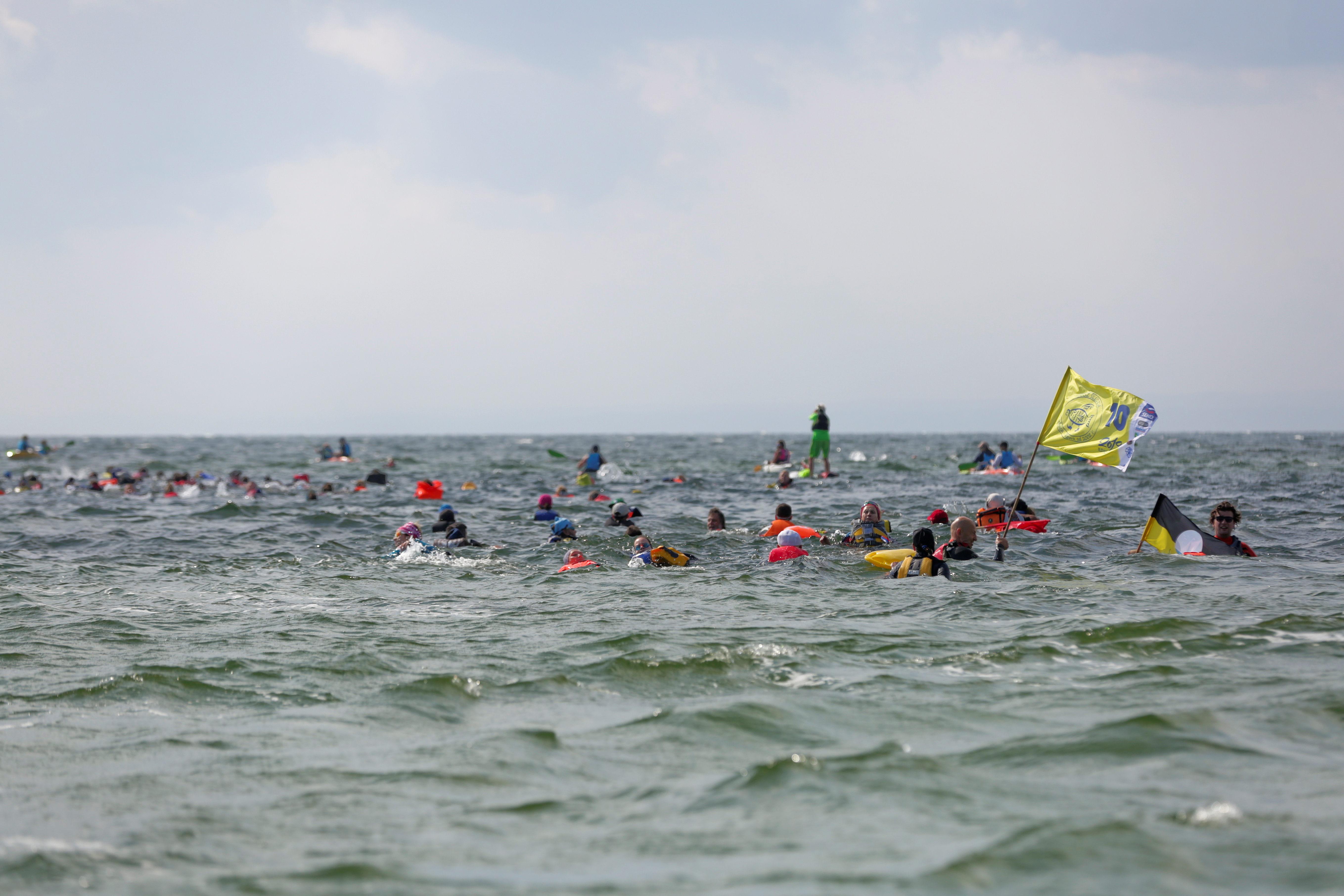 Poles wade through Baltic 'like herrings' to commune with the sea