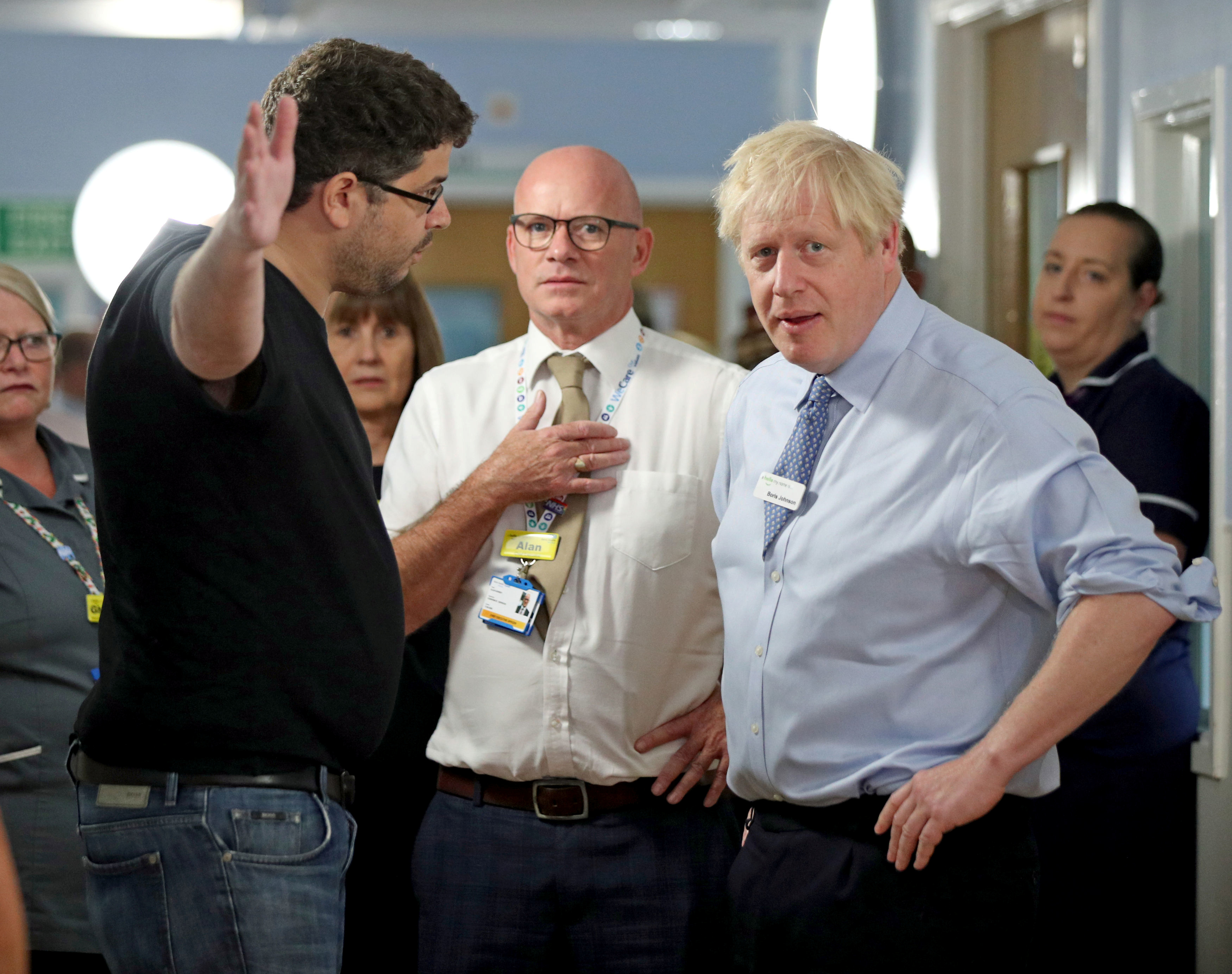 British PM Johnson confronted at a hospital by parent of sick child