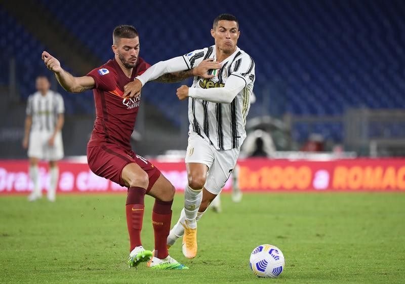 Ronaldo double earns point for 10-man Juventus at Roma