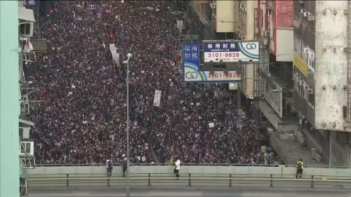 Thousands march in Hong Kong as government urges calm   Reuters Video