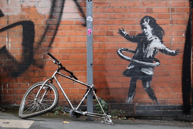 British artist Banksy claims hula-hooping girl street art