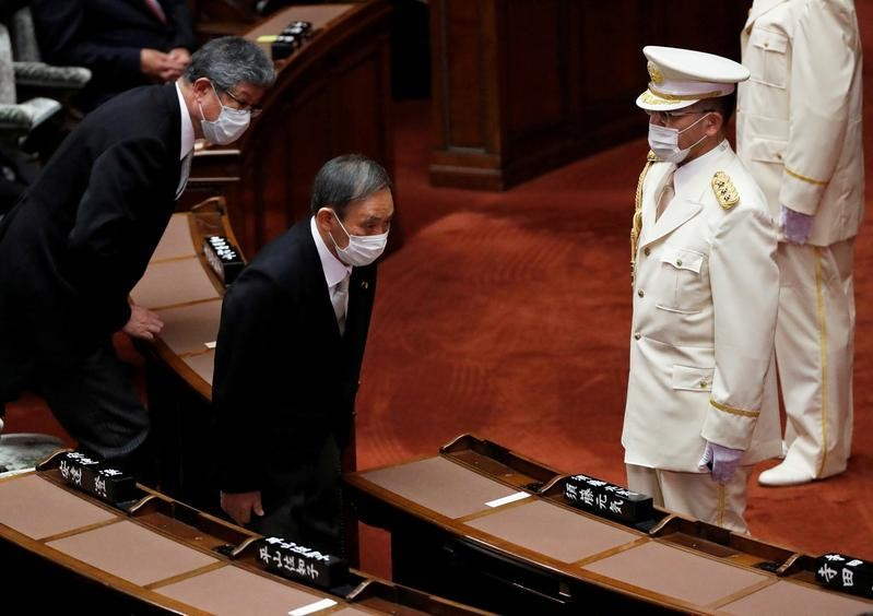 Japan's Suga hopes for 'forward-looking' ties in letter to South Korea's Moon