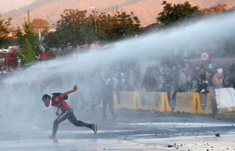 Chile anniversary rallies turn violent as churches burned, police fire tear gas